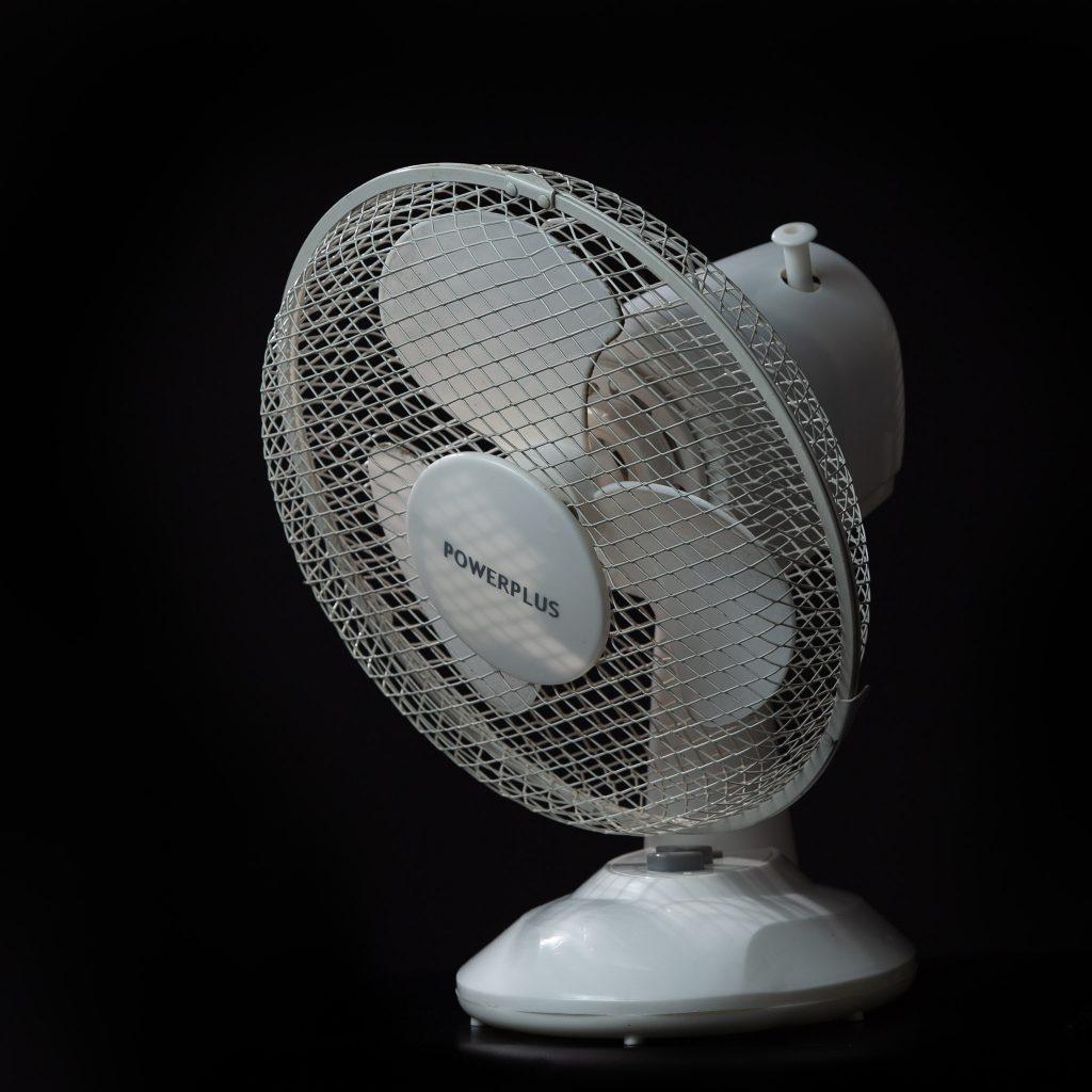 white fan on a black background